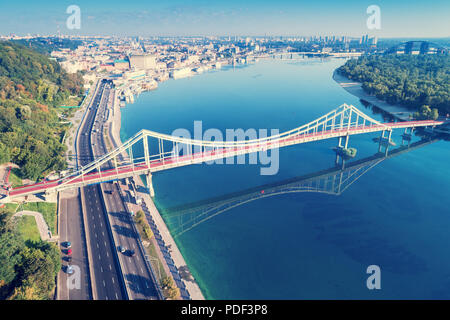 The city of Kiev. Dnieper. Aerial view of District of Podil and the Pedestrian bridge - Stock Photo