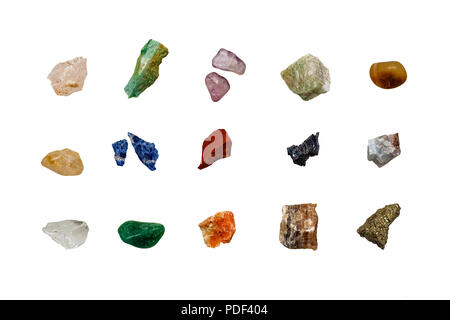 various colored raw gemstones fragments on white background - Stock Photo