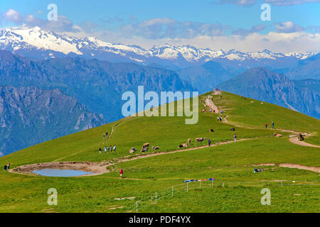 Hiker on a trail to view point Colma di Malcesine, Monte Baldo, Malcesine, Lake Garda, province Verona, Lombardy, Italy - Stock Photo