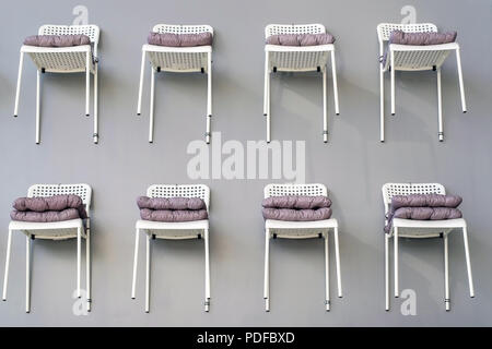 Chairs on the wall decor. Chairs with soft covers. Not a standard curious review - Stock Photo