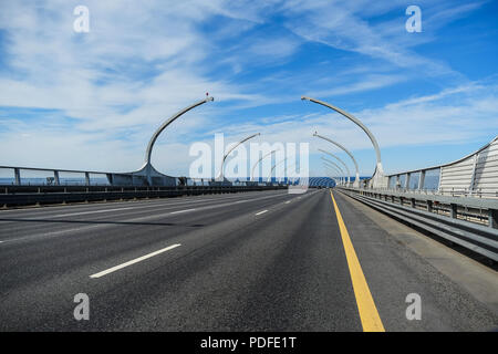 Modern bridge. Western high-speed diameter on the background of the sea and blue sky. Modern city buildings. - Stock Photo