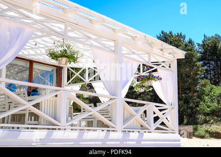 Table setting at tropical beach restaurant, sea - Stock Photo