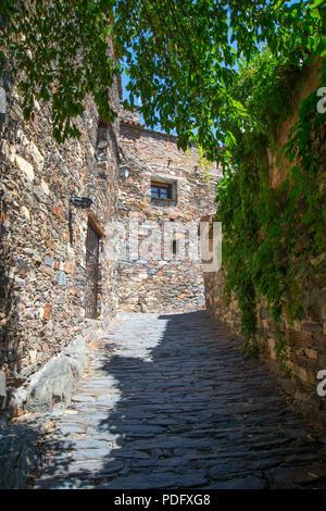 Cobbled street. Patones de Arriba, Madrid province, Spain. - Stock Photo