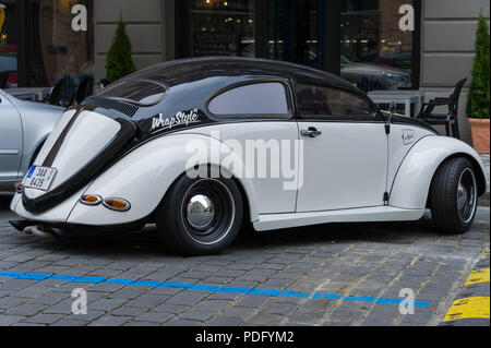 Customised black and white Volkswagen Beetle parked on a street in Prague - Stock Photo
