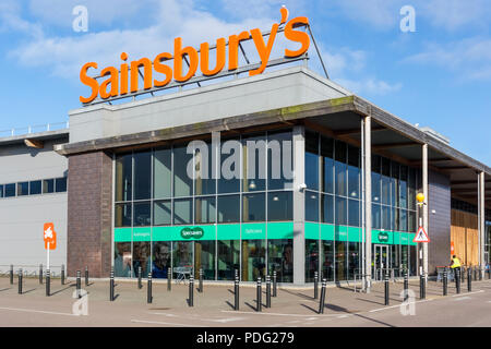 A branch of Sainsbury's containing a Specsavers opticions in King's Lynn, Norfolk. - Stock Photo
