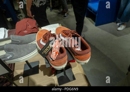 Vans brand sneakers on display the opening celebration of the new J. Crew men's store in the Dumbo neighborhood of Brooklyn in New York on Wednesday, August 8, 2018. The 2,100 square foot location, the brands second store in Brooklyn, is located in the historic Empire Stores warehouse complex and features a barber shop, and locally sourced merchandise besides their own signature brands. (© Richard B. Levine) - Stock Photo