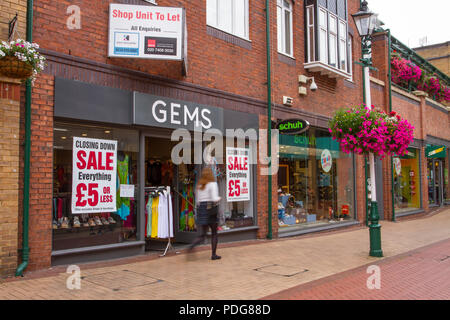 Gems Discount Sale, Shop & Shoppers, Fashion Stores with summer collection window displays, Retail units To Let, Closed, Closing down, Shuttered shops, shop front, businesses in decline, with poor retail sales in Sheffield, UK - Stock Photo
