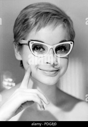 1960s glasses. A young woman in glasses and bows January 1961. Models name Monica Flodqvist - Stock Photo
