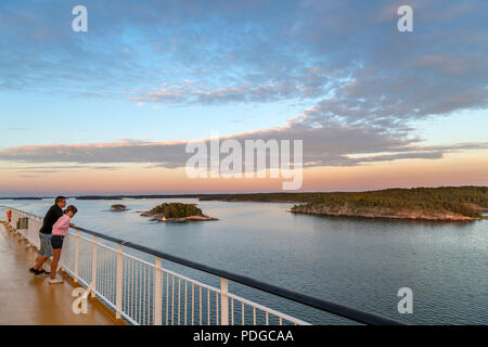 View from the deck of the Turku to Stockholm ferry at sunset, Turku Archipelago, Finland - Stock Photo