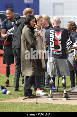 Prince Harry and Ms Meghan Markle as they attend the UK Team Invictus Games trials held at Bath University Sports training village in Somerset. - Stock Photo