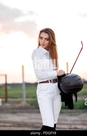 portrait of elegant rider woman with whip - Stock Photo