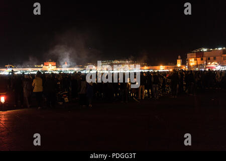 Famous Jemaa el-Fnaa Square in Marrakesh at Night - Stock Photo