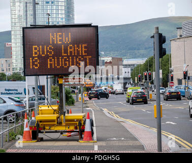 Belfast, Northern Ireland, UK -  4 August 2018: Sign on Sydenham Road indicating that a bus lane takes comes into operation on August 13 - Stock Photo