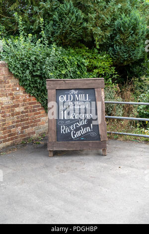 Old Mill Hotel advertising chalk board in Harnham Salisbury Wiltshire UK - Stock Photo