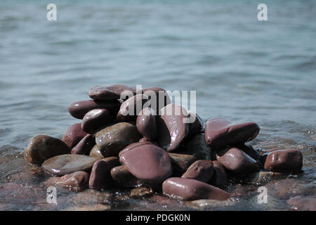 A Pile of Rocks on The Beach - Stock Photo