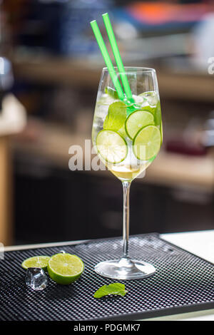 Cocktail drink or lemonade with cucumber on barcounter. - Stock Photo
