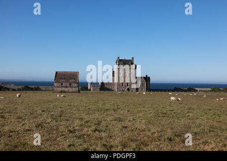 Ackergill Tower Hotel near Wick, Caithness which overlooks the North Sea near the Pentland Firth - Stock Photo