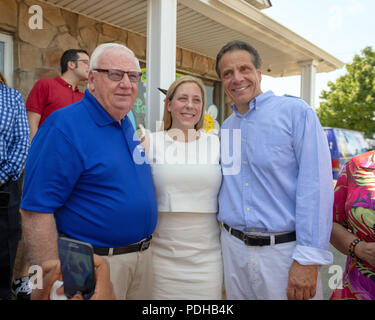 Massapequa, New York, USA. 5th Aug, 2018. L-R, NY Senator JOHN BROOKS; LIUBA GRECHEN SHIRLEY, Congressional candidate for NY 2nd District; and Governor ANDREW CUOMO, running for re-election, pose among supporters during opening of joint campaign office for the 2 Long Islanders, aiming for a Democratic Blue Wave in November midterm elections. Credit: Ann Parry/ZUMA Wire/Alamy Live News - Stock Photo