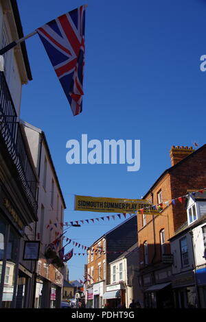 Union Jack and Bunting Flying Over Fore Street at Sidmouth Folk Festival, East Devon, UK. August, 2018. - Stock Photo