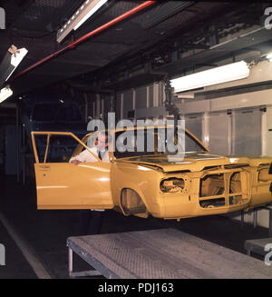 Early 1970s, British car production, picture shows the manufacture of the Vauxhalll Victor motorcar, Luton, Bedford, England, UK. An inspector checks the painted body before assembly. The Victor was a larger version of the smaller and popular Viva model. - Stock Photo