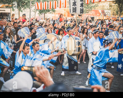 Moscow, Russia - August 09, 2018: Traditional japenese Awa Dance. Dancers perform the Bon Odori dance, musicians in blue kimono with big drum odaiko d - Stock Photo