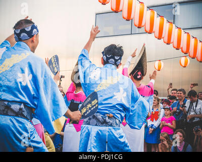 Moscow, Russia - August 09, 2018: Traditional japenese Awa Dance. Dancers perform the Bon Odori dance during the summer japanese festival celebrations - Stock Photo