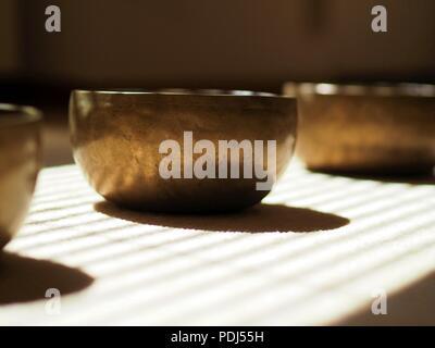 Singing bowls, close up, for mediatation or sound massage - Stock Photo