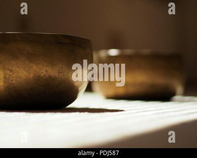 Singing bowls, close up, for mediatation or sound massage - Stock Photo