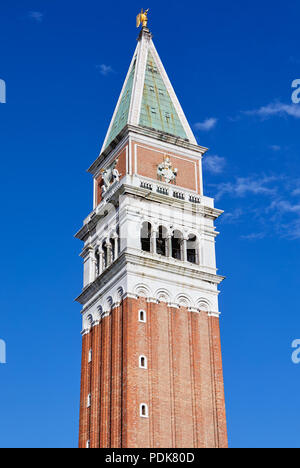 Saint Mark bell tower in Venice in a sunny summer day, blue sky - Stock Photo