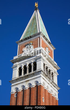 San Marco bell tower close up in Venice in a sunny summer day, blue sky - Stock Photo
