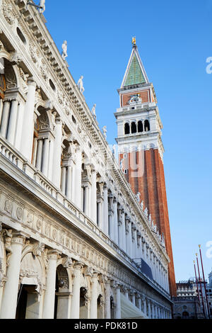 Venice, National Marciana library building and San Marco bell tower, blue sky in a sunny day in Italy - Stock Photo