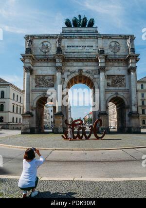 Munich, Germany - July 29, 2018: Victory Gate triumphal arch, Siegestor in Munich Bavaria Germany - Stock Photo