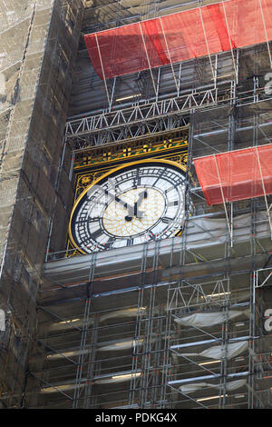 the Elizabeth Clock tower, housing Big Ben bell, covered in scaffolding during exrensive repairs and renovation. Palace of Westminster, Houses of Parl - Stock Photo