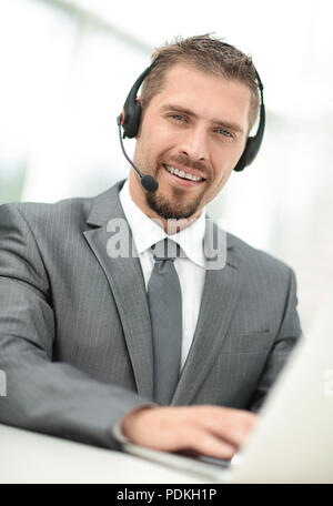 young agent of the call center with the headphones. - Stock Photo