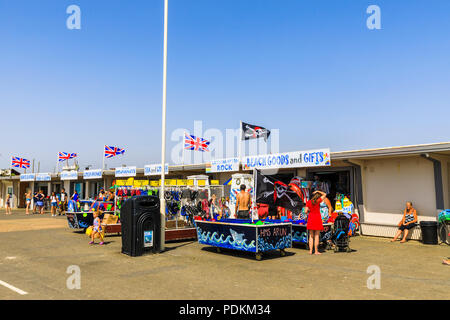 Beach cafes and shops on the seafront promenade at Littlehampton, a small holiday resort on the south coast in West Sussex, UK in summer - Stock Photo