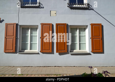Windows with shutters on a small street in Vilnius - Stock Photo