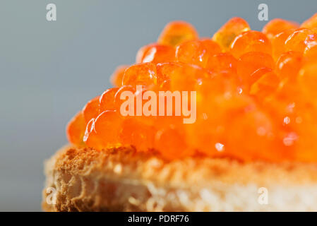 Sandwich with red caviar - Stock Photo