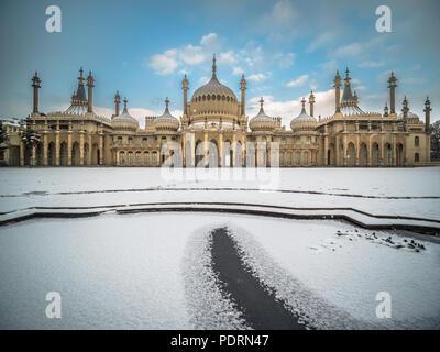 Snow covered Brighton Royal Pavilion pond - Stock Photo