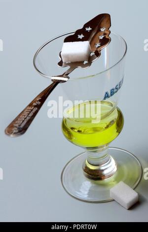 Glas Absinth mit Absinthloeffel und Wuerfelzucker, Gruene Fee - Stock Photo