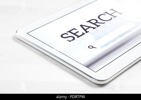 Search engine app on tablet screen. Application to find website or service with smart mobile device. - Stock Photo