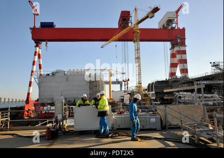 STX shipyards in Saint-Nazaire (north-western France), on 2017/11/15: workers on board the the MSC Bellissima cruise ship under construction and huge  - Stock Photo