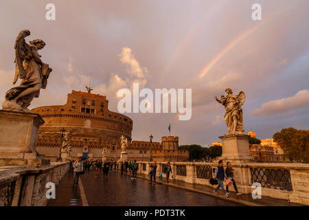 A St Angelo's Castle view in golden hour with a double rainbow. Rome, Italy. - Stock Photo