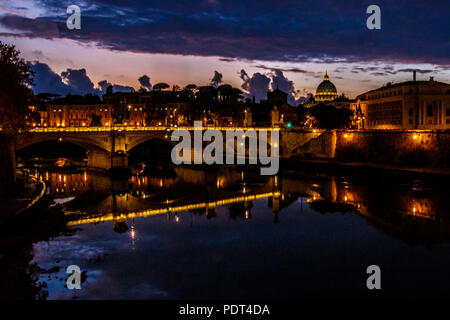 A view over Tiber river with Vittorio Emanuele II bridge and St. Peter's Basilica at Rome, Italy. - Stock Photo