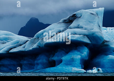 The icebergs of Jokulsarlon Lagoon are the best known and the largest of a number of glacial lakes in Iceland. - Stock Photo