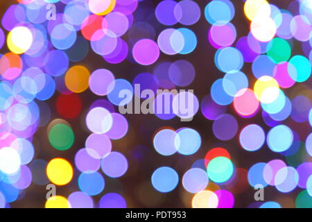 Out of focus abstract of Christmas Tree light. - Stock Photo