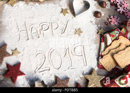 Happy 2019 text made with flour. Ingredients for cooking christmas baking. Top view. - Stock Photo