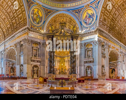 Vatican city, Vatican - October 12, 2016: Bernini's Baldacchino Altar and ornate frescoes in the Saint Peter's Basilica in Vatican City - Stock Photo