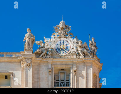 The clock and sculptures by Maderno's on Saint Peter's Basilica facade in Vatican City - Stock Photo