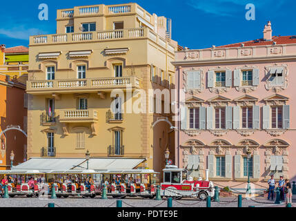 Monaco Ville, Monaco - October 7, 2016: Red and white trackless train of Monaco in front of the princial palace. The Palace Square or Place du Palais  - Stock Photo