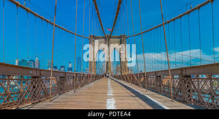 New York, United States of America - June 2, 2016: Panoramic view of the Brooklyn Bridge in New York, NY, one of the oldest suspension bridges in the  - Stock Photo
